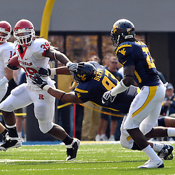 Oct 4, 2008; Morgantown, WV, USA; Rutgers running back Jourdan Brooks (39) stiff arms his way past West Virginia defensive lineman Scooter Berry (93) during the second quarter of West Virginia's 24-17 victory over Rutgers.