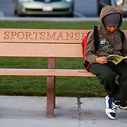 The First Tee of Monterey County opens the door to golf, as well as academic tutoring,  to many underprivileged kids of Salinas, CA, like Jose Calderon, seen reading while waiting for his parents.