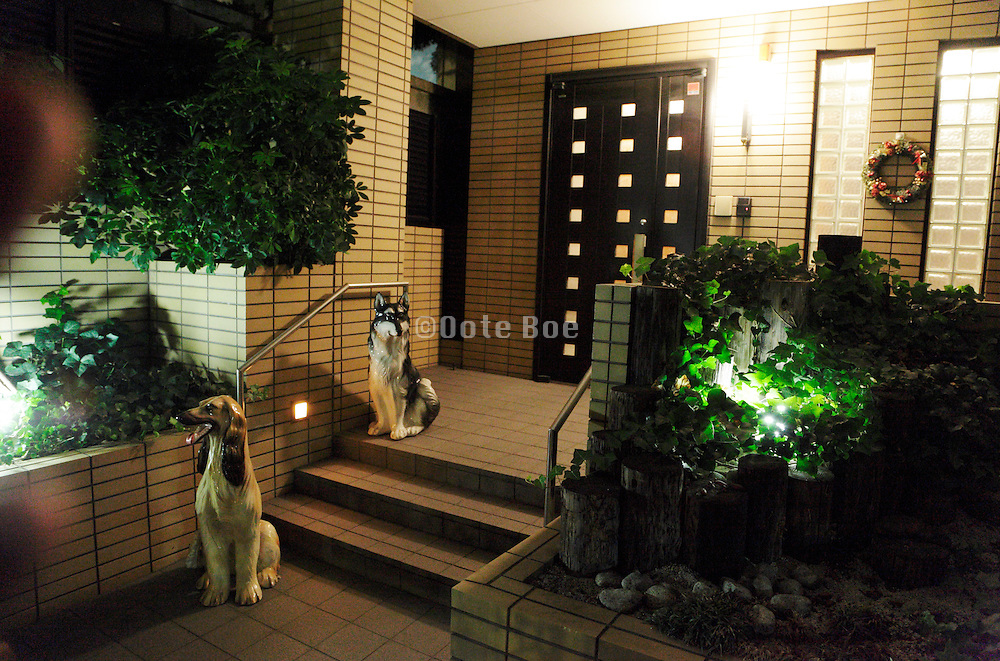 entrance to house with two life sized dog statues