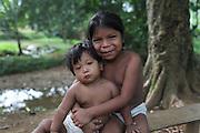 Ngäbe children sit next to a stream. COCABO: Junquito, Almirante, Changuinola, Bocas del Toro, Panamá. September 1, 2012.