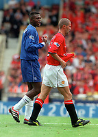 Marcel Desailly (Chelsea) talks to Roy Keane (Man Utd) as he walks to the changing rooms after being sent off. Chelsea v Manchester United. FA Charity Shield. Wembley 13/8/00. Credit: Colorsport.