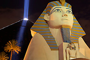 Luxor Hotel Sphinx and pyramid at night with beam of light arising from pyramid