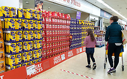 © Licensed to London News Pictures. 14/04/2020. London, UK. Shoppers look at a large selection of unsold Easter Eggs at Sainsbury's supermarket in north London. The government had ordered people to 'Stay home this Easter' during coronavirus lockdown to slow the spread of COVID-19 and reduce pressure on the NHS. Photo credit: Dinendra Haria/LNP