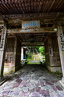 """Shoruji Temple Gate - temple No. 36 on the Shikoku Pilgrimage, located on a peninsula jutting into the Pacific Ocean. Pilgrims used to have to reach the temple by ferry, but in 1975 a bridge was built. The deity of the temple is is venerated as the guardian of fishermen. Shoryuji is known as the """"Green Dragon Temple"""". The environment is fantastically beautiful with bamboo forests and stairs dotted with statues and path markers. Shouryuuji is truly a highlight for any pilgrim. This temple houses the fierce """"Dragon Fudou""""."""