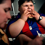 Dzhambulat Khotokhov, 6, one of the fattest boys in the world, eats with his mother in Nal'chik, in southern Russia. Now 1.4 metres tall and weighing about 100 kg, Khotokhov has grabbed world attention as the biggest kid in the world since he was three. .Khotokhov lives with his mother Neyla and his brother, 14-year-old Mukha. .