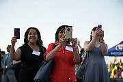 Guests take photos of award winners during the Silicon Valley Business Journal 40 Under 40 event at Avaya Stadium in San Jose, California, on July 31, 2018. (Stan Olszewski for Silicon Valley Business Journal)