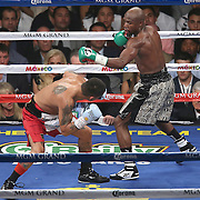 LAS VEGAS, NV - SEPTEMBER 13: Marcos Maidana (L) avoids a punch by Floyd Mayweather Jr. during their WBC/WBA welterweight title fight at the MGM Grand Garden Arena on September 13, 2014 in Las Vegas, Nevada. (Photo by Alex Menendez/Getty Images) *** Local Caption *** Floyd Mayweather Jr; Marcos Maidana