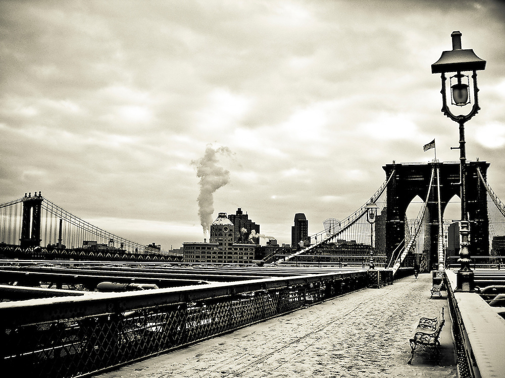The Brooklyn bridge promenade covered with snow, with the clock tower building located in DUMBO in the background, Brooklyn, new York, 2008.