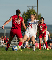 Laconia's Rebecca Howe makes a quick pass off Berlin's Joslyn Lanteigne during NHIAA Division III soccer at Robbie Mills Field Tuesday afternoon.  (Karen Bobotas/for the Laconia Daily Sun)