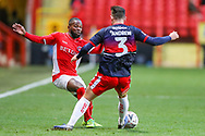 Charlton Athletic midfielder Mark Marshall (7) is tackled by Doncaster Rovers defender Danny Andrew (3) during the The FA Cup 2nd round match between Charlton Athletic and Doncaster Rovers at The Valley, London, England on 1 December 2018. Photo by Toyin Oshodi