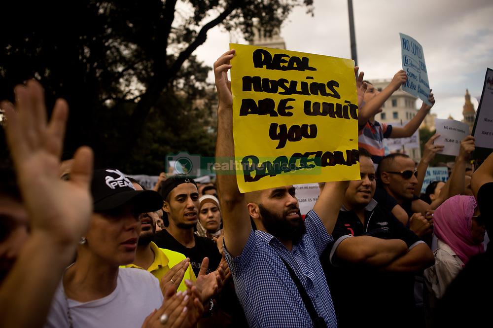 August 21, 2017 - Barcelona, Catalonia, Spain - A man holds a banner during a march of the Muslim comunity in Barcelona. Representatives of various Catalan Muslim associations have  gathered in  Barcelona  in memory of  terror attack victims and against terrorism the same day that Younes Abouyaaqoub, identified as driver of van that sped down Las Ramblas on Thursday, has been shot dead by Catalan police officers in the village of Subirats. (Credit Image: © Jordi Boixareu via ZUMA Wire)