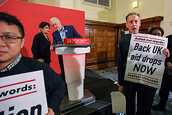 © Licensed to London News Pictures. 10/12/2016. London, UK. Labour leader and the leader of opposition JEREMY CORBYN and Shadow Attorney General SHAMI CHAKRABARTI are interrupted by 'Syria Solidarity UK' protesters whilst speaking on human rights at the Methodist Central Hall in Westminster, London on Saturday, 10 December 2016. Photo credit: Tolga Akmen/LNP