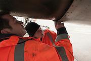 Emmanuel  and Nesrine,  aircraft inspectors, check loose plates of a plane. With one order, they can immobilise a Boeing or delay the taking off for 300 passengers on an intercontinental flight. When Operating Technical Inspectors (CTE) get aboard , it is always in pairs and always unexpected. That day, Emmanuel Lainé (L) and Nesrine Chkioua (R), one of the only three women in France to do this job, control an international flight to Taipei and a cargo plane bound for Lebanon.<br /> <br /> D'un ordre, ils peuvent immobiliser un Boeing ou retarder le décollage des 300 passagers d'un long courrier. Quand les contrôleurs techniques d'exploitation (CTE) débarquent, c'est toujours en binôme et toujours à l'improviste. Ce jour-là, Emmanuel Lainé (G) et Nesrine Chkioua (D), l'une des 3 femmes CTE en France, passent au crible un vol international pour Taipei et un avion de fret en partance pour le Liban.