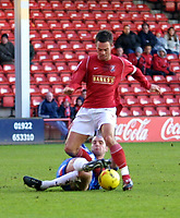 Photo: Dave Linney.<br />Walsall v Hartlepool United. Coca Cola League 1. 17/12/2005.Daniel Fox(Walsall) rides the challenge from  Ben Clarke(Hartlepool)