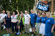 Former Labour Party leader Jeremy Corbyn poses outside Parliament with Matthew Tovey and other NHS workers from the grassroots NHSPay15 campaign before a march to 10 Downing Street to present a petition signed by over 800,000 people calling for a 15% pay rise for NHS workers on 20th July 2021 in London, United Kingdom. At the time of presentation of the petition, the government was believed to be preparing to offer NHS workers a 3% pay rise in recognition of the unique impact of the pandemic on the NHS.