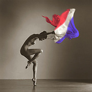 Black and white photo of nude dancer with colored French Flag
