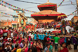 Spectators cheer as the Kumari of Tokha approaches.