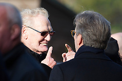 © London News Pictures. 05/11/2014. Cream Guitarist ERIC CLAPTON (left) and Cream drummer GINGER BAKER (right) talking before the service. The funeral Jack Bruce at Golders Green Crematorium in North London. Jack Bruce was the lead singer and bass player for British Rock band Creme, alongside Eric Clapton and Ginger Baker. Creme sold over 15 million albums worldwide and were widely considered to be the worlds first successful supergroup. Photo credit : Ben Cawthra/LNP