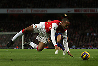 Photo: Paul Thomas.<br /> Arsenal v Manchester United. The Barclays Premiership. 21/01/2007.<br /> <br /> Thierry Henry of Arsenal is tackled by Gary Neville (L out of picture) inside the penalty box.... was it a penalty??? Thierry Henry thought it was a penalty.