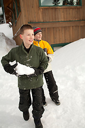 North America, United States, Washington, boy (age 10) with snowball on Crystal Mountain  MR
