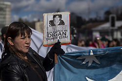 September 4, 2017 - Puerto Montt, Chile - Relatives and friends held a demonstration to commemorate the 12 years of the disappearance of the young José Huenante at the hands of the Chilean policeJosé Gerardo Huenante Huenante, a 16-year-old boy, was arrested and made to disappear by the Chilean police on September 3, 2005 in the city of Puerto Montt in southern Chile. José disappears during the government of the Concertación chaired by Ricardo Lagos. He is the second detainee disappeared in civilian governments. The body has not yet been found 12 years after his arrest and the culprits are still at large in Puerto Montt, Chile. (Credit Image: © Fernando Lavoz/NurPhoto via ZUMA Press)