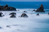 The full moon lights up the rugged Big Sur coastline, California.