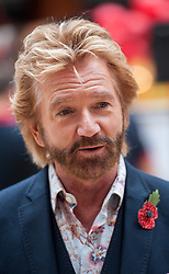 © Licensed to London News Pictures. 29/10/2015. Bristol, UK. Bristol Poppy Day. NOEL EDMONDS joins poppy sellers to raise the profile of the Royal British Legion's campaign in Bristol at Cabot Circus shopping centre, in the two week countdown to Remembrance Day. Photo credit : Simon Chapman/LNP