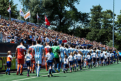 the teams of The Netherlands and Argentina enter the pitch during the Champions Trophy finale between the Netherlands and Argentina on the fields of BH&BC Breda on Juli 1, 2018 in Breda, the Netherlands.