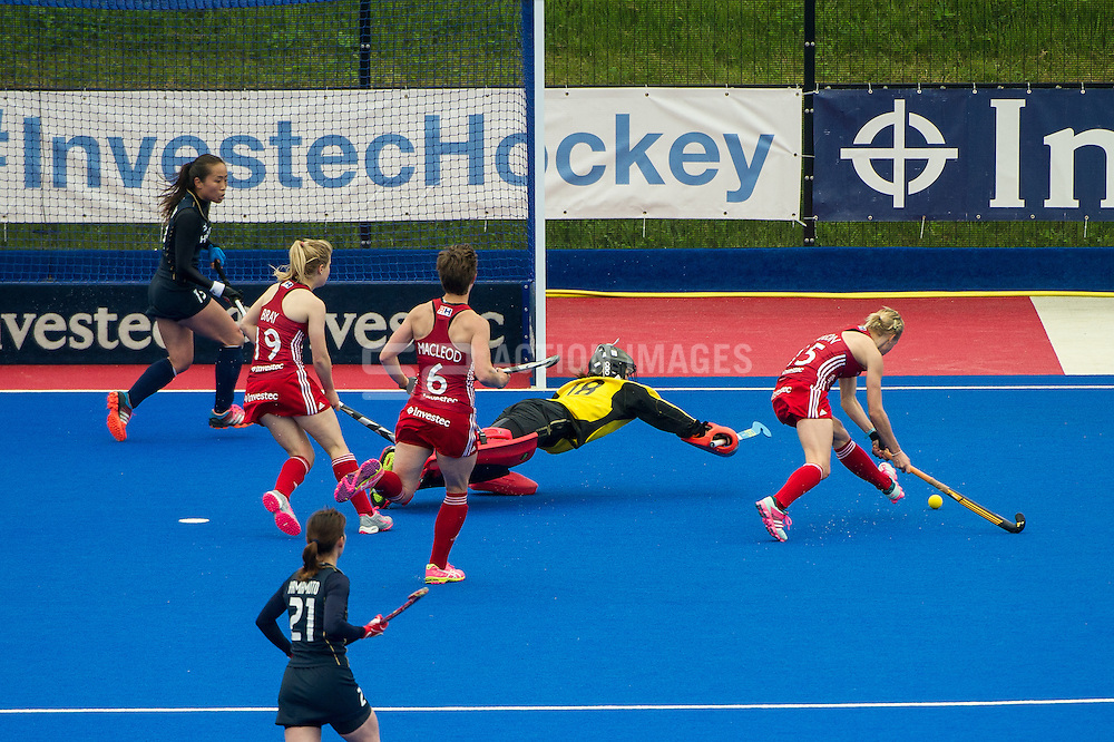 Great Britain's Alex Danson goes round Sakiyo Asano in the Japan goal to score. Great Britain v Japan - Investec Private Banking International, Lee Valley Hockey & Tennis Centre, London, UK on 26 April 2015. Photo: Simon Parker