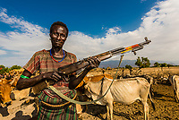 Man of the Arbore tribe carrying a Russian SKS semi-automatic carbine in their village in the Omo Valley, Ethiopia. The men carry wepaons when they got out to herd cattle and there are occasional skirmishes with other tribes.