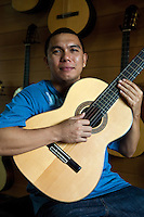 """Mark Alegre, 4th generation luthier at Alegre Guitars - Though pre-colonial Visayans had a variety of string instruments which used a coconut shell or gourd as resonator - the guitar is a Spanish introduction into the Philippines. Guitars have been made in Cebu since the Spanish period mainly as a makeshift replacement for organs for church music until they were later imported. Guitars developed as a local industry only in the present century, receiving a boost from the government's promotion of cottage industries in the immediate postwar period. In Mactan, the craft of guitar making passes from generation to generation and the industry involves many families, the most prominent of whom is the Alegre and Malingin families whose names have become well-known """"brand names"""" of Mactan or Cebu guitars."""