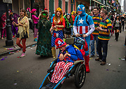 Families dressed up during Mardi Gras on 25th February 2020 in the French Quarter of New Orleans, Louisiana, United States. Mardi Gras is the biggest celebration the city of New Orleans hosts every year. The magnificent, costumed, beaded and feathered party is laced with tradition and  having a good time. Celebrations are concentrated for about two weeks before and culminate on Fat Tuesday the day before Ash Wednesday and Lent.