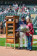 Ron Gardenhire #35 of the Minnesota Twins poses with his wife next to a custom humidor given to him as a gift from the team to celebrate his 1000th career win from a few days earlier before a game against the Oakland Athletics on April 9, 2014 at Target Field in Minneapolis, Minnesota.  The Athletics defeated the Twins 7 to 4.  Photo by Ben Krause