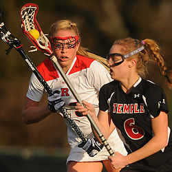 Rutgers junior midfielder Stephanie Anderson (13) defends Temple junior midfielder Charlotte Swavola (6).Temple defeated Rutgers 12-11 in NCAA women's college lacrosse at the Rutgers Turf Field in Piscataway, N.J.
