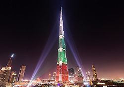 1 Dec 2013, Dubai; Burj Khalifa Tower floodlit in the white, green and red colours of the flag of the United Arab Emirates (UAE) to celebrate the 42nd National Day of the UAE; Credit: Iain Masterton / Alamy Live News