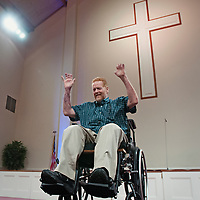 Lee Spearman preaches of his faith and recovery in front of the congregation at Clinton Family Worship Center in Clinton, N.C., Sunday, March 16, 2014. Lee Spearman was hospitalized in December of 2013 with an infection that was ravaging his body and almost took his life and resulted in having both of his legs amputated below the knee and all the fingers on his left hand. Photo By Mike Spencer/StarNews Media