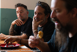 Devil Chicken artist Chris Galley, Cool Beans Chris Marino and Led Sled's Pat Patterson having lunch at the Hotel Benju in Kushma on Motorcycle Sherpa's Ride to the Heavens motorcycle adventure in the Himalayas of Nepal. On the sixth day of riding, we went from Tatopani to Pokhara. Saturday, November 9, 2019. Photography ©2019 Michael Lichter.