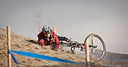 SHOT 1/12/14 1:16:19 PM - A Women's Elite racer crashes while warming up before the race at the 2014 USA Cycling Cyclo-Cross National Championships at Valmont Bike Park in Boulder, Co.  (Photo by Marc Piscotty / © 2014)