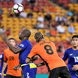 BRISBANE, AUSTRALIA - JANUARY 31: Serge Kaole of Global FC heads the ball under pressure from Jacob Pepper of the Roar during the second qualifying round of the Asian Champions League match between the Brisbane Roar and Global FC at Suncorp Stadium on January 31, 2017 in Brisbane, Australia. (Photo by Patrick Kearney/Brisbane Roar)