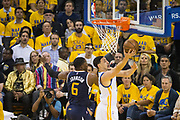 Golden State Warriors guard Klay Thompson (11) takes the ball to the basket against Utah Jazz forward Joe Johnson (6) during Game 2 of the Western Conference Semifinals at Oracle Arena in Oakland, Calif., on May 4, 2017. (Stan Olszewski/Special to S.F. Examiner)
