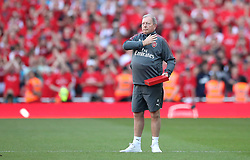 Arsenal kit manager Vic Akers salutes the fans after his final home game before leaving the club during the Premier League match at the Emirates Stadium, London.