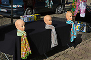 Mannequins with colourful scarves in a street market, 10th May 2015, Esperaza, France.