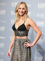 """Actoress Jennifer Lawrence poses during the photocall before the press conference for the film """"Mother"""" at the Tiff Light Box for the Toronto International Film Festival 2017"""