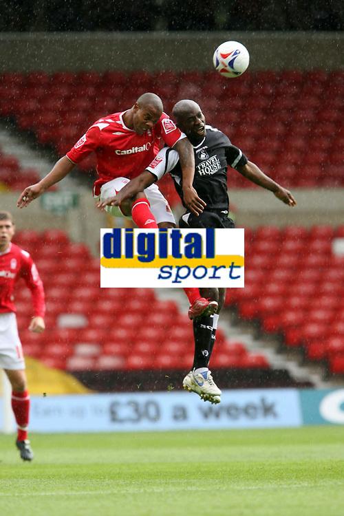 Photo: Pete Lorence.<br />Nottingham Forest v Swansea City. Coca Cola League 1. 30/09/2006.<br />Junior Agogo leaps over Ezomo Iriekpen.