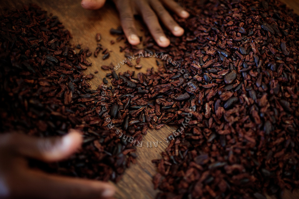 A worker is selecting toasted cocoa, during the last process before it becomes chocolate, in the technical area of Claudio Corallo's Nova Moca plantation, on the island of Sao Tome, Sao Tome and Principe, (STP) a former Portuguese colony in the Gulf of Guinea, West Africa.