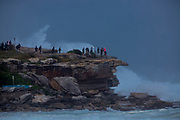Sydney, Australia. Sunday 24th May 2020. Bondi Beach in Sydney's Eastern suburbs experiences very rough surf conditions today with  massive waves. People seen watching the rough surf conditions at Ben Buckler Point, Bondi.