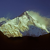 Dawn light illuminates the south face of Cho Oyu, on the border between Nepal and Tibet.