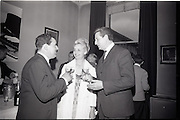 24/06/1965<br /> 06/24/1965<br /> 24 June 1965<br /> Gilbeys Ireland Ltd. reception at Gilbey's Wine Merchants, Nos. 46-49 O'Connell St., Dublin, for the presentation of a consignment of Dry Monopole Champagne to the organisers of Le Bal des Petits Lits Blancs. Image shows Mr. David I. Dand (left), Director, Gilbeys of Ireland Ltd., with Madam Lambert and M. Rene Lambert, Chairman, Organising Committee of the ball.