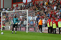 Photo: Paul Thomas.<br /> Walsall v Swansea. Coca Cola League 1.<br /> 27/08/2005.<br /> <br /> Extra marshalls are called in as Cardiff keeper Willy Gueret winds up the Walsall crowd after going 5 - 2 up.