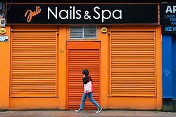 Glasgow, Scotland, UK. 12 March 2021. On the day Covid-19 lockdown is relaxed slightly in Scotland the city centre streets in Glasgow city centre remain almost deserted virtually all shops ad cafes are still closed. Pic; Spa and beauty parlour is closed and shuttered. Iain Masterton/Alamy Live News